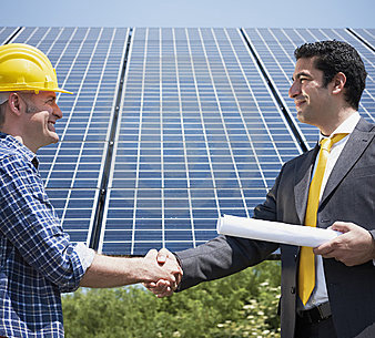 electrician and businessman shaking hands